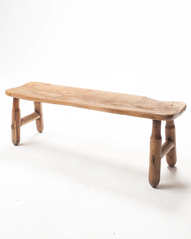 Front view of Wood Hewn Farm Bench