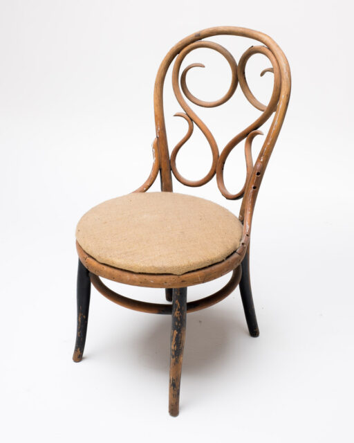 Front view of Cane Swivel Wooden Chair