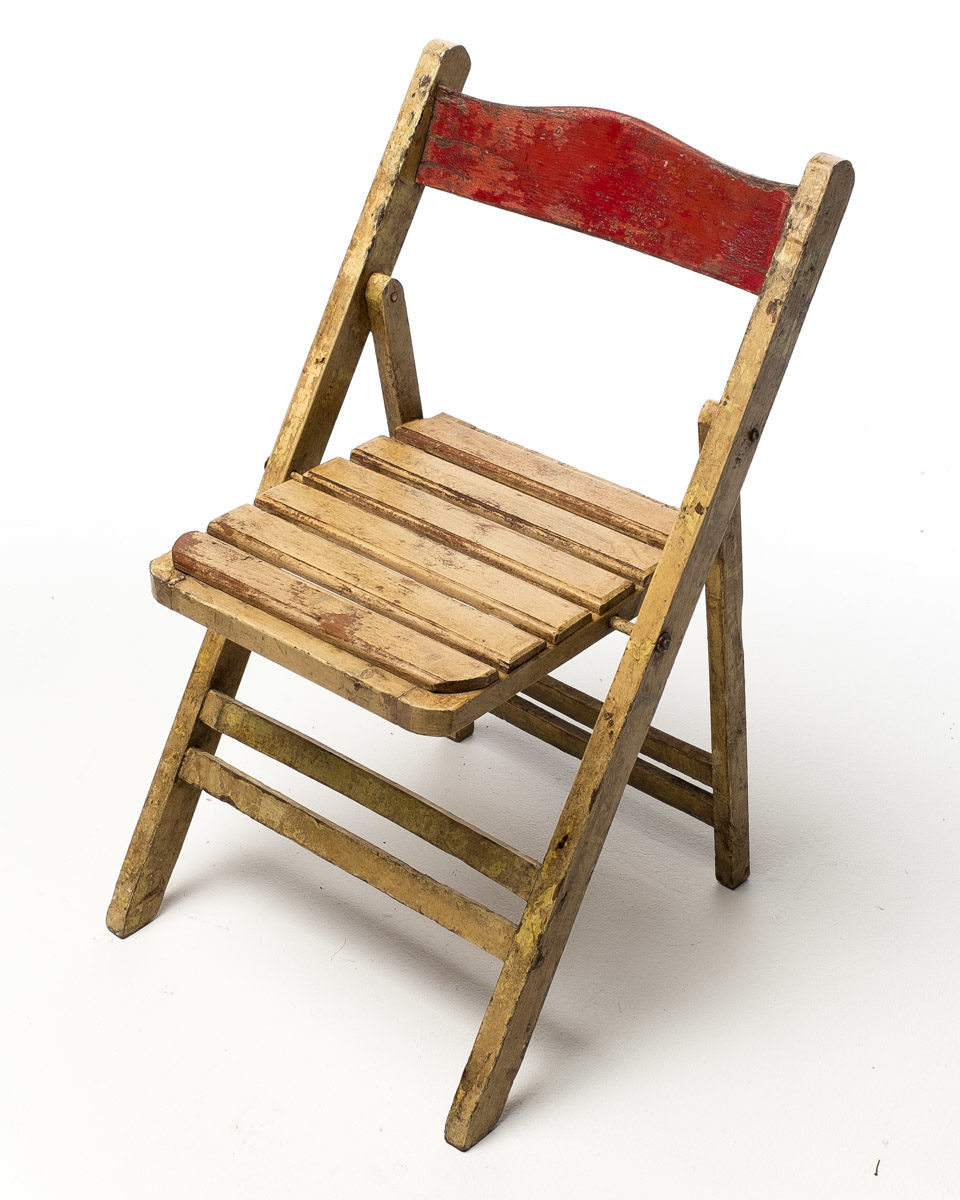 Front view of Distressed Wood Folding Chair