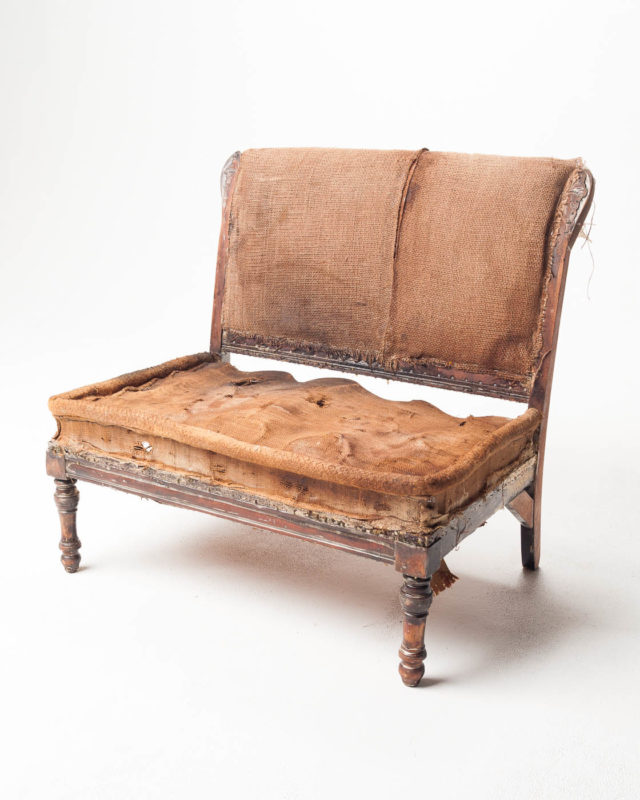 Front view of Burnish Distressed Settee