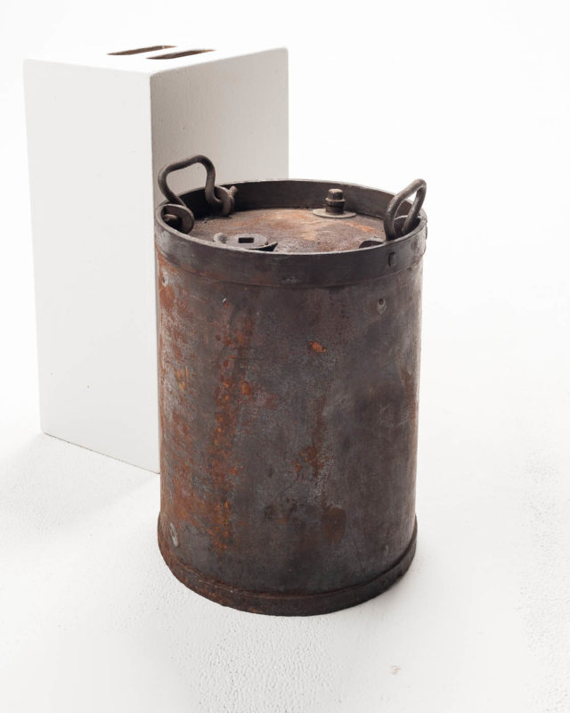 Front view of Rusted Short Metal Barrel