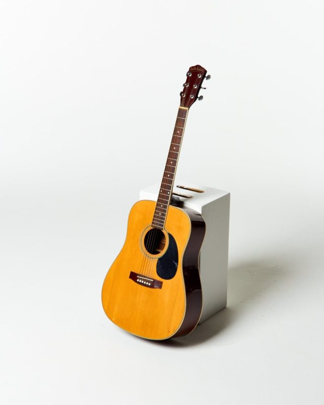 Front view of Buck Accoustic Guitar