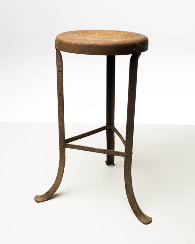 Front view of Cain Rusted Three Leg Stool