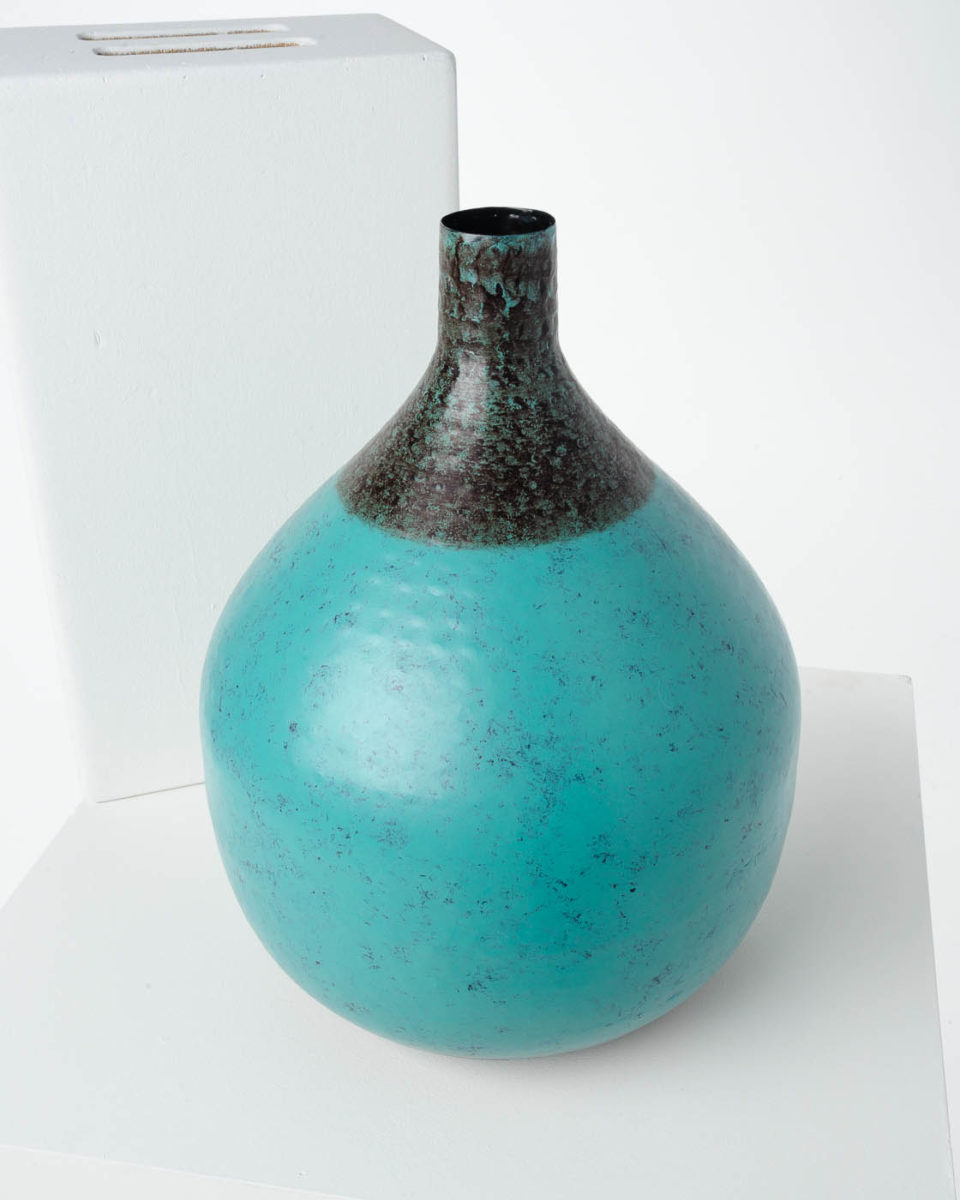 Front view of Pinch Teal Vase