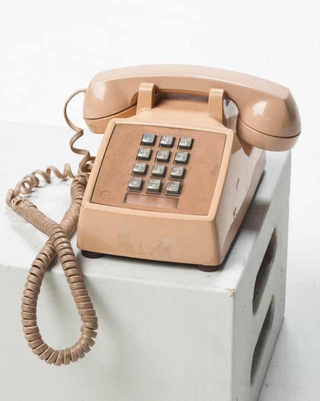 Front view of Beige Table Top Touch Dial Phone