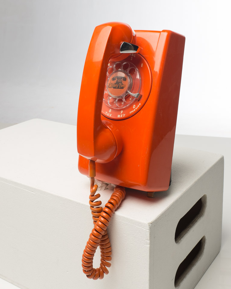 Front view of Orange Rotary Wall Phone