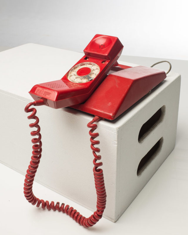 Front view of Red Retro Rotary Phone