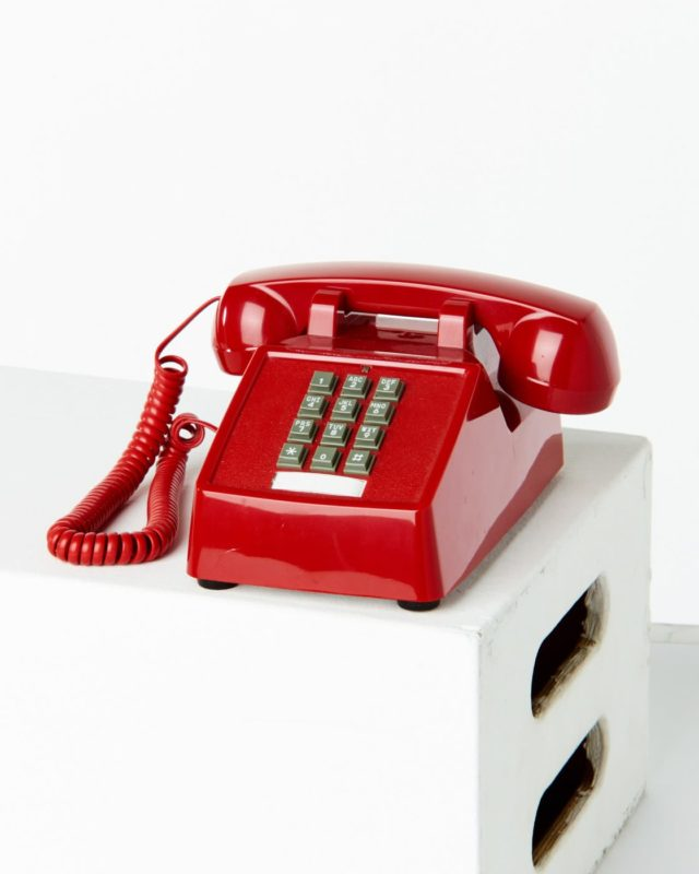 Front view of Smith Red Touch Tone Phone