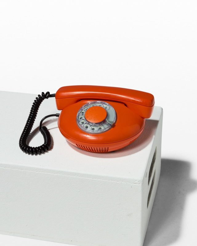 Front view of Ron Orange Rotary Phone