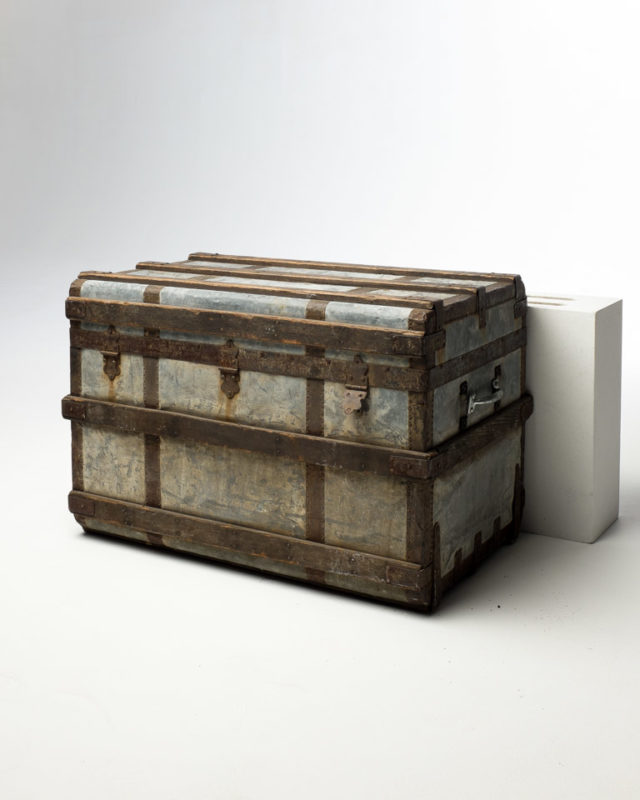 Front view of Distressed Metal Lined Wooden Trunk