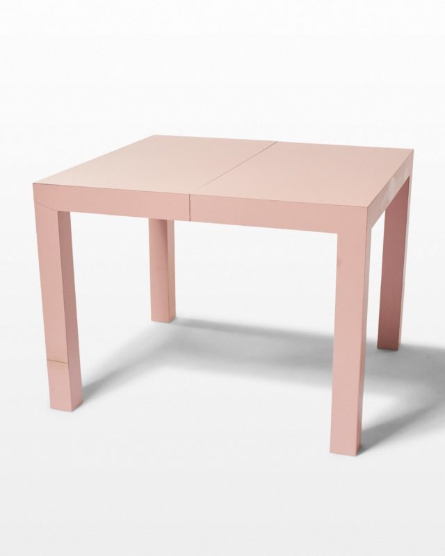 Front view of Zara 3-Leaf Expandable Blush Laminate Dining Table